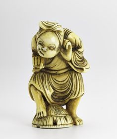 Netsuke of carved ivory, a man standing with one foot on a basket, unsigned: Japan