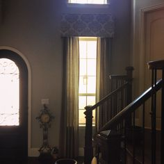My client wanted to dress up her entry way. So I chose a patterned cornice board with nail heads and soft grey solid panels.  #dallas #windowtreatments  www.traditionswindowdecor.com