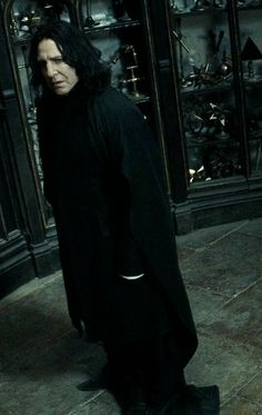 Severus Snape. Oh my gosh this picture just speaks levels of him. It's one of the times his mask falls, and you just see all that pain and anguish and self-hatred bottled up and the love he uses to fuel him to keep going, to keep him living despite his thoughts that he isn't worthy of it. Oh my gosh, I love Severus Snape.❤️❤️