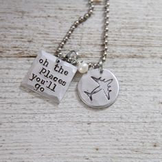 Youre off to great places. Youre made to do great things. Youre meant to climb mountains. Take hold of your wings and believe the message - Oh the Places Youll go! These inspirational words are hand stamped into thick metal charms, one square and one circle. The circle shows our hand sketched airplane, made exclusively for The Rusted Chain.Each charm is about 3/4 in width. Both are hammered for a rustic casual feel. These are strung on an 18 stainless...