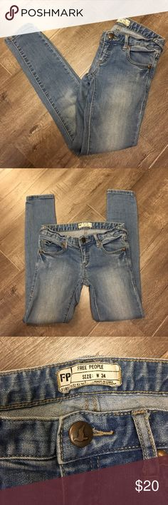 """SALE Free People skinny jeans Free People. Size 24. Skinny jeans in a light wash. 74% cotton 19% polyester 5% rayon 2% spandex. Low rise. Intentional distressing and fading. Approx. Inseam 27"""", rise 6"""", waist 13.5"""" across front lying flat. Gorgeous jeans. In excellent condition. Free People Jeans Skinny"""