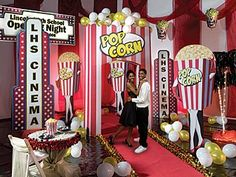 popcorn decorations for door? Make banner? red/white streamers, white/gold balloons...
