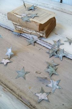 Stars...could be cut from tin, could be paper sprayed with paint and distressed, could be polymer clay, etc.