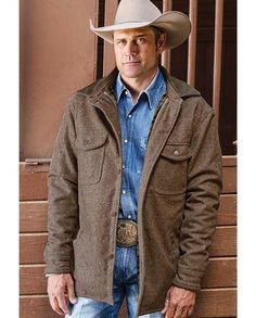 Men's Taupe Wool Jacket features a wool body, plaid flannel lining and a leather collar. It also has 4 exterior pockets and a metal button closure on the front, on the cuffs and on the chest pockets. Chest pockets are trimmed in leather. | gifts for cowboys men man drysdales.com western menswear rancher outerwear rugged durable resilient comfortable cold weather gear warm comfortable outerwear fall winter outdoors snow rain sleet wind rancher ranchwear