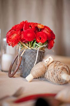 Stunning red ranunculus in a rustic setting.