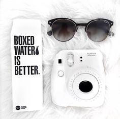 Instax mini 8 and boxed water is life