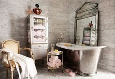 A vintage feel grey bathroom with a hint of cream and yellow.