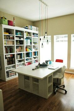Arts & Crafts room: huge windows for light, lots of shelving & large table with storage for workspace