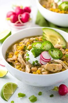 White bean chicken chili simmered in a crockpot with whole roasted jalapenos, tender beans, corn, and lean chicken breast. A healthy recipe pack with flavor and spice.