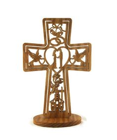 What a wonderful wedding gift to give with this unique wedding cross. Nestled inside the cross is bells, rings, doves,hearts, bride, groom, flowers, cross, and a church. This is sure to be the best gift you could give to those select people that already have most everything they might need..It is unique and very doubtful that any other guest would get the same gift. This wedding cross is made out of hand selected oak lumber.