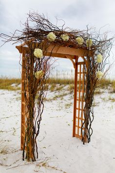 beach wedding floral & branch ceremony arch by Fishers Flowers / photo: katescaptures.com