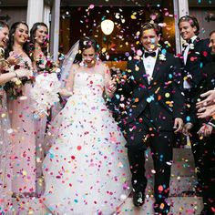 Throw the confetti it's finally Friday! We're loving this swoon-worthy photo from a @bigcitybride wedding   by @studiothisisphotography