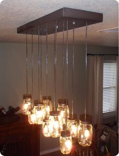 This chandelier is one of my first projects to create for my daughter's loft condo.  What an awesome idea and a great way to save some moo-la making a knock-off from Pottery Barn's $400 version.