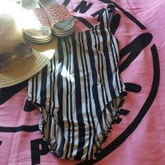 Sexy gorgeous Anne Klein striped swimsuit. 14. This is an Prime, absolute perfect condition. So super SEXY! The stripes running vertically Slim your figure Down. Super flattering. Not one flaw. No fading. Built-in bra, no padding. Just a gorgeous flattering swimsuit. Love the super low scoop back. TV $40. Thanks so much for shopping my closet! ann klein Swim One Pieces