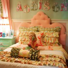 Love the ruffled pillow shams and bedspread and the two-tone walls