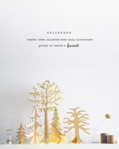 Lovely idea—Collect wooden trees over the years & create an eclectic display of different varieties. Eat Drink Chic