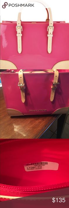 """Dooney & Bourke Patent Leather Satchel in Pink Gorgeous Authentic Dooney & Bourke Patent leather Satchel with extended shoulder strap in Pink! This bag is barely used and is in excellent condition! Button closure with zipper pocket inside along with three other pockets for all your storage needs! Feet on the bottom, stays clean and perfect size for the gal on the go! Has small pen mark on inside (see pic). Satchel measures at 12-3/4"""" W by 9""""H by 4-1/4 deep. Open to reasonable offers…"""