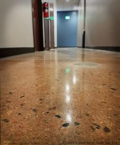Polished concrete is a very versatile flooring system - a close up shot of the floors at Loveland Community Yoga shows the large, exposed aggregate in the concrete. #ConcreteVisions #polishedconcrete #stainedconcrete #Loveland #yogastudio #exposedaggregate