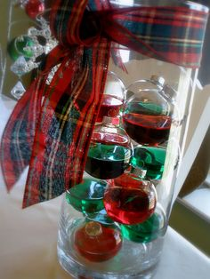 simple, cheap centerpiece; colored water in clear ornaments, could even do with glitter