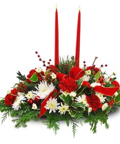 Loaded with holiday cheer, this centerpiece features an assortment of red & white flowers, taper candles, red berries and holiday greens. Christmas Flower Arrangements, Christmas Flowers, Christmas Centerpieces, Floral Arrangements, Christmas Holidays, Christmas Wreaths, Christmas Decorations, Merry Christmas, Christmas Gifts
