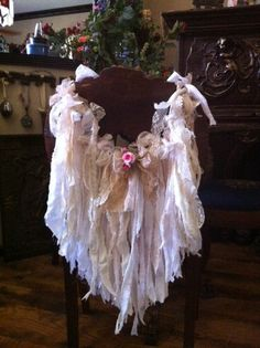 2 garlands MADE TO ORDER ROMANTIC PRAIRIE LACE GARLAND- GORGEOUS GORGEOUS GORGEOUS This listing is for one custom order chair garland. You will receive a garland that looks like the garland in the picture. The garland is made to order especially for you! Freatures a lot of vintage materials, lace, and flowers displayed in the shape of angel wings. Use the garland for: home decor tea party chair decor wedding chair decor bridal shower chair decor baby shower chair decor ...