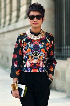 Esther Quek // bold print top + statement necklace + high-waisted trousers + bangles.