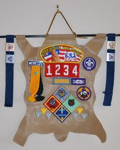 Skin Display of Cub Scout Achievements - Skin & Arrow with Council patch, unit number, & Arrow of Light Patch can be presented at Arrow of Light Ceremony