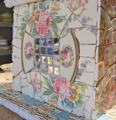 "rimmed edges of plate become shutters on this little mosaic house; flowers ""climb"" up walls"