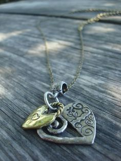 Metal Hearts Unite Charm Necklace by hotglued on Etsy