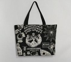 Black spirit board inspired spooky tote bag, grocery tote, spooky trick or treat bag market bag, library bag, occult skeleton Library Bag, Trick Or Treat Bags, Black Thread, Market Bag, Black Cotton, Printing On Fabric, Reusable Tote Bags, Spirit, Buy And Sell