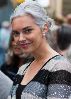 I like how she goes with the pretty silvery hair by wearing a pretty silvery, spangly sweater in various shades.