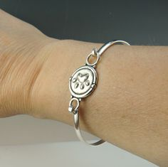 BR56- Sterling Silver Paw Print Cuff Bracelet - Handmade One of a Kind Artisan Jewelry Made in the USA. Denim and Diamonds Jewelry