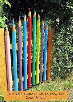 34 Easy and Cheap DIY Art Projects To Dress Up Your Garden - Colorful pencils garden gate.