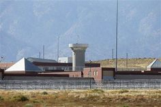 A guard tower looms over a federal prison complex which houses a Supermax facility outside Florence, in southern Colorado, Thursday, Oct. 15, 2015. The prison is among those being assessed by a team of Pentagon officials as potential sites to house Guantanamo detainees amid the Obama administration's stalled effort to close the controversial facility.
