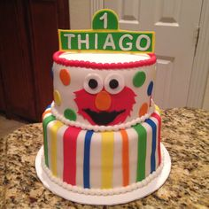 Elmo first birthday cake.  Cream cheese cake with guava/cheese filling.  Fondant decorations.  https://www.facebook.com/sweetnsassycakesbyeva
