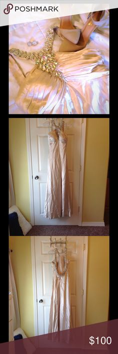 Satin Halter Neck Dress Classy but fun champagne formal dress. Beautiful low back. Has has beadwork repaired to look like new. Has one small stain near zipper and some staining and fringes on the hem. Mystique Dresses Prom