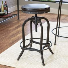 Features:  -Do have a powder coated finish that makes them rust resistant.  -Material: Iron and faux leather.  -Swivel adjustable seat, iron studded details.  -Antiqued pewter finish.  -Seat color: Br