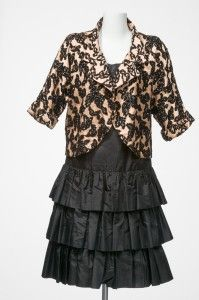 Gwen Gillam, black dress in French silk taffeta with three-tiered skirt and self-tie belt. Theatre jacket in black and pale apricot silk brocade featuring dolman sleeves and a curved front opening, ca. 1960s / Queensland Museum http://www.qm.qld.gov.au/ | thefashionarchives.org