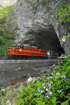 The red Norfolk Southern heritage unit pulls through the Natural tunnel.