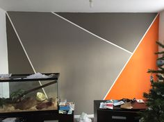 Excuse the mess but just finished our feature wall #orange #grey #featurewall