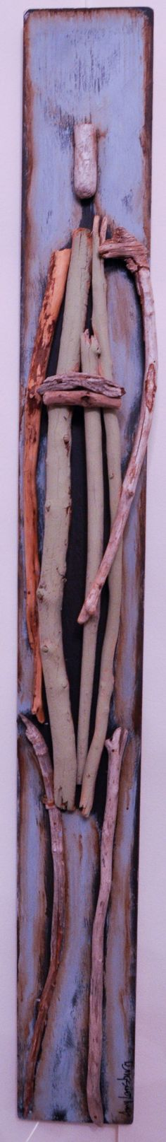 Figures made from driftwood by Amy Lansburg.