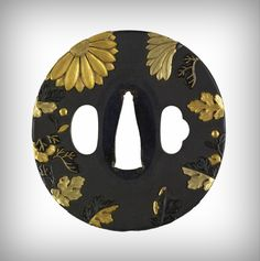 Tsuba with flowers and leaves.