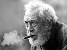 John Huston smoking a cigar.