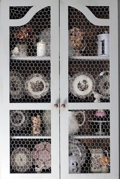 Chicken wire in place of glass. Adds texture, more casual, no breakage worries.