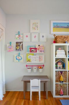 This girls room decor has a cute bespoke headboard to match the shape of the round bed, studded with mismatched floral buttons for a fun, girly look. ... But the sophisticated armoire and chandelier mean that it will suit her for years to come, and can be easily updated by changing the bedding and accessories.  #GirlsRoomDecor #GirlsRoomDecor10YearsOld