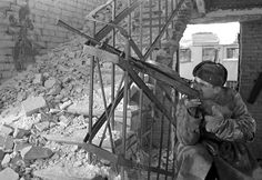 "historywars: "" Battle of Stalingrad: Red Army machine gunner deploys inside a ruined building with his DP-27 MG. After the initial phase in the summer-fall 1942 """
