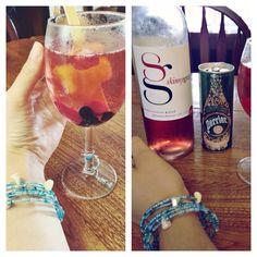 Homemade mixed drink: strawberry wine, pomegranate Perrier, orange Popsicle, frozen berries. #Homemade #WineCharm #MatchingBracelet