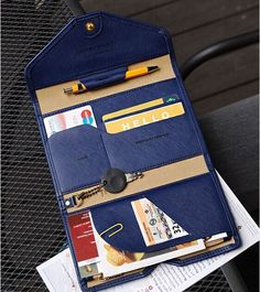 To all stylish and savvy travelers, this is for you! This wallet will hold your passport, ID cards, keys while you fly to your next destination. - Zipper pocket - Receipt pocket - Passport pocket - Bo