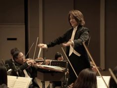 Tomomi Nishimoto, conductor. *gahhhhhhh*