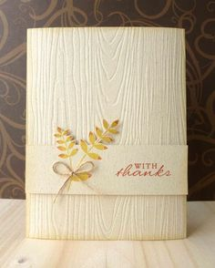 handmade card by Lorena Canto/Paperella Plays .... white wood grain embossed card cover ... yellow leaves tied with a bit of string ... clean and simple ...